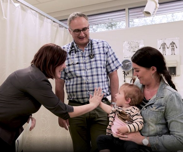 A doctor in Karratha providing healthcare to a child